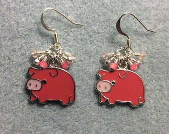 Dark and light pink enamel pig charm earrings adorned with tiny dangling dark and light pink Chinese crystal beads.