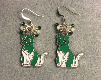 Green and white enamel cat charm earrings adorned with tiny dangling green and white Chinese crystal beads.