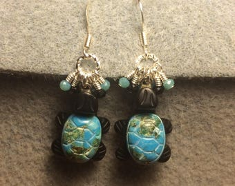 Black onyx and turquoise gemstone turtle beads adorned with tiny dangling turquoise and black Chinese crystal beads.