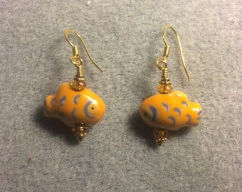 Tangerine ceramic fish bead earrings adorned with tangerine Chinese crystal beads.