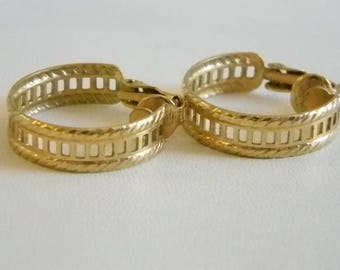 Muted Gold Tone Hoop Clip On Earrings