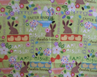 Easter Green multicolor glitter  fabric designed for Jo-Ann Fabric that has 1 yard by 44 inches with eggs  chicks bunnies and more.