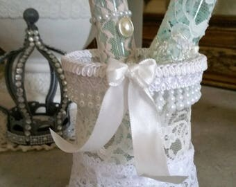 set pot and pieces of lace and pearls Shabby chic style