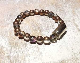 9mm Beaded Stretch Bullet Bracelet with glass copper colored/clear beads. Nickel bullet casing bracelet.