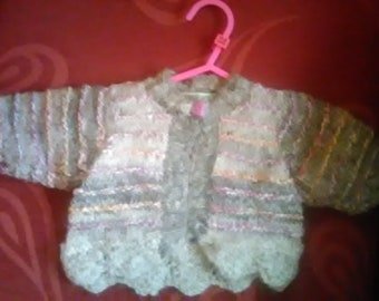 Hand knitted Cardigan, knitted in home spun wool to fit a baby girl aged 0-3 months old