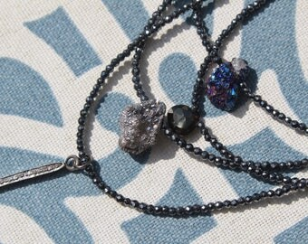 Gemstones on Hematite