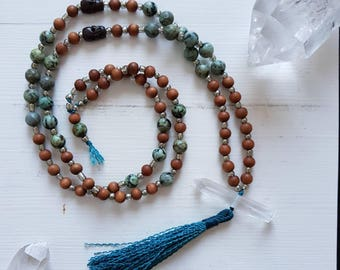 Mala inspired meditation necklace with African turquoise, sandal wood, tibetian skull beads, and clear quartz