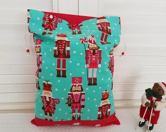 Nutcracker snow on my pouch turquoise background.