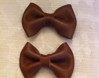 two brown leather knot