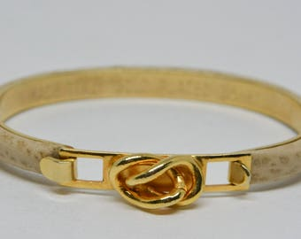 Lovely gold tone and leather cuff bracelet