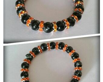 Black and gray beads _ cups orange bracelet