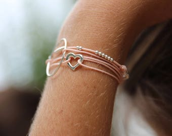 Silver heart and pink cord bracelet