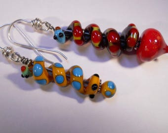 Bright colored coiling snake earrings in  blue, yellow and red asymmetrical coils
