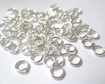 250 4mm silver jump rings