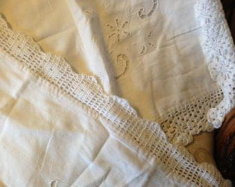 Two vintage 30's  lace crochet edged embroidered vintage pillowcases. 33 insx25inches. Good