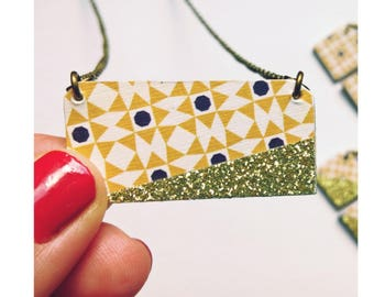 Long necklace with mustard yellow pattern and gold sequin geometric pendant