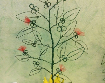 red flowers made of wire plant sculpture
