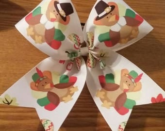 Thanksgiving bow made with 3 inch wide ribbon and ponytail holder