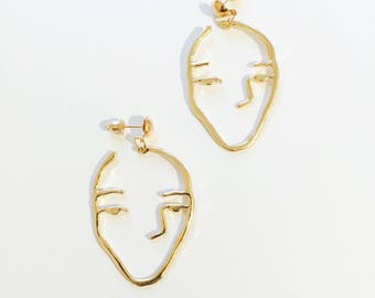 Sleepy face earrings