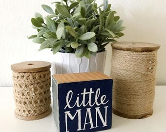"wood sign: ""little man"""