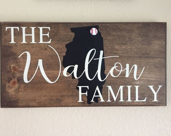 Custom wooden name sign with embellishment