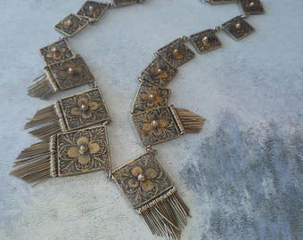 Delicate vintage gilded filigree and fringed necklace.