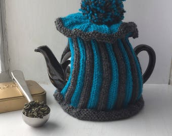 Hand knitted striped tea cosy for 6 cup teapot