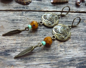Triskell earrings bronze, yellow glass bead, blue seed beads and feather, Celtic style charm.