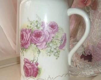 Pitcher with roses and lily of the valley