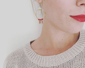 Earrings and plated gold and red beads