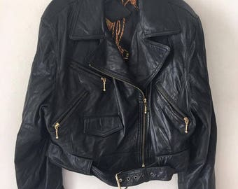 Motorcycle leather jacket from real soft leather retro vintage style with many pockets old steep women's black color jacket has size-large.