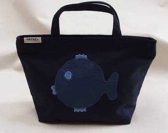 a small bag is Navy with a blue fish