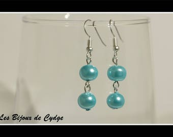 Earring and turquoise glass beads