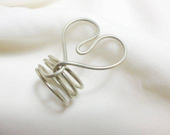 Modern handmade ring in silver, heart-shaped
