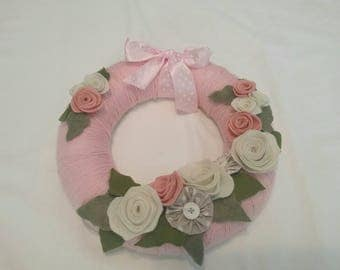 Wool wreath covered with felt flowers