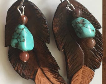 Leather hand-carved earrigs.