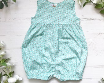 Pretty Turquoise Blue Ditsy Floral Doily Print Cotton Romper. 0-4 years.