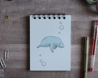 NOTEPAD. A6 Cute Manatee Spiral Notepad. Soft 300 gsm Card Cover. 120 blank pages. Matte lamination pleasant to the touch.