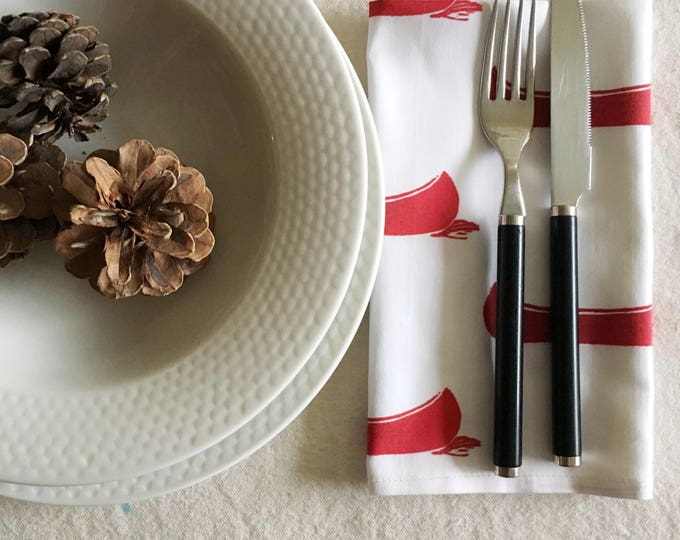 set of four organic cotton dinner napkins, red canoes