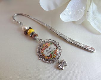 """Metal bookmark featuring a cabochon resin inlays """"centerpiece kisses"""""""