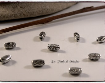 Set of 4 - 5x4mm - ref:l86 silver patterned Metal beads