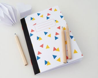 Cahier A6 illustré de triangles multicolores