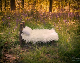 Newborn bed in the wood