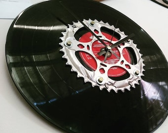Wall clock made with an old chainring and a vinyl record