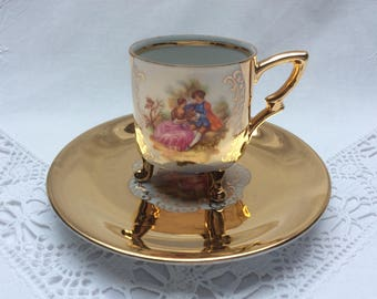 Vintage demitasse tea cup and saucer with Fragonard courting couple, gold decorated, German porcelain, Bavaria