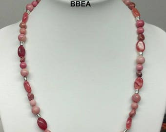 Finery in Rhodocrosite, stone of protection against jealousy, necklace and bracelet.