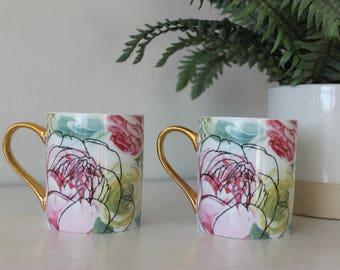 Two beautiful flower mugs