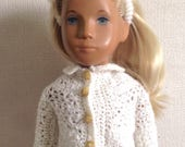 Soft white White crochet cardigan for Sasha doll with collar and tortoiseshell buttons