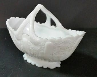 Vintage milk glass oval bowl. Button and daisy pattern with twig handles