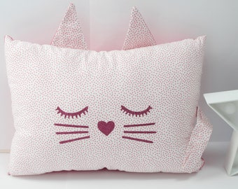 Cushion Pink kitten sleeping